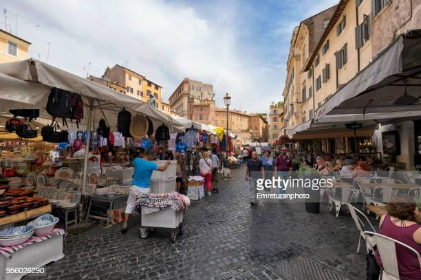 flower market in rome with vendors,restaurants and people on a sunny day. - emreturanphoto stock pictures, royalty-free photos & images