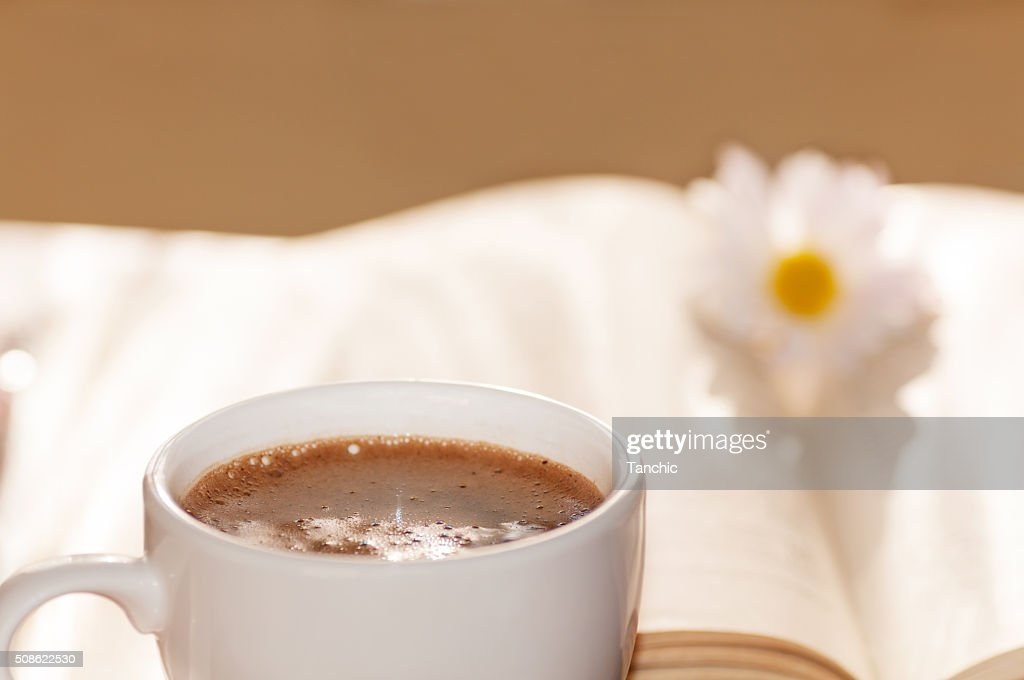flower on the book, the Cup of black coffee : Stock Photo