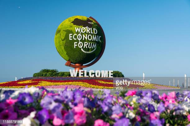A flower parterre with the logo reading 'World Economic Forum' is seen ahead of the World Economic Forum Annual Meeting of the New Champions 2019 at...