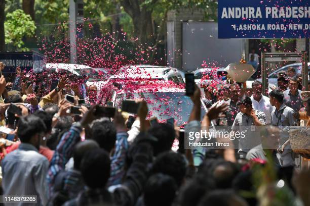 Flower petals are showered on the cavalcade of YSR Congress Party chief Jaganmohan Reddy as he arrives at the Andhra Bhawan on May 26 2019 in New...