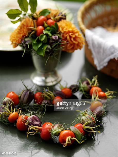 Flower posy and rosehip heart on table