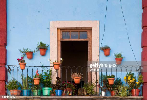 Flower pots on balcony of apartment in downtown Guanajuato Mexico