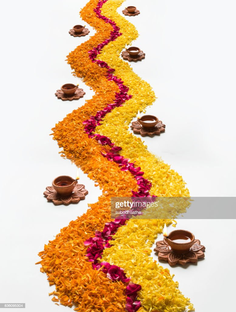 Flower Rangoli For Diwali Or Pongal Made Using Marigold Or Zendu Flowers And Red Rose Petals Over White Background With Diwali Diya In The Middle Selective Focus High Res Stock Photo Getty