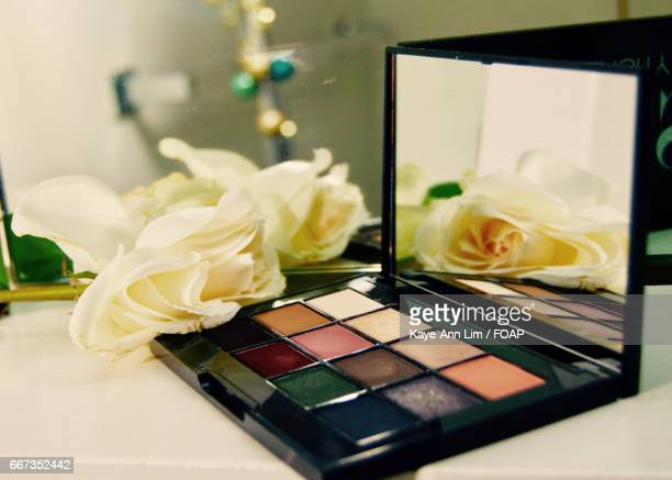 Flower reflected on mirror of make-up kit