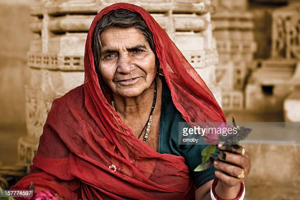 flower saleswoman of ranakpur - jain stock photos and pictures