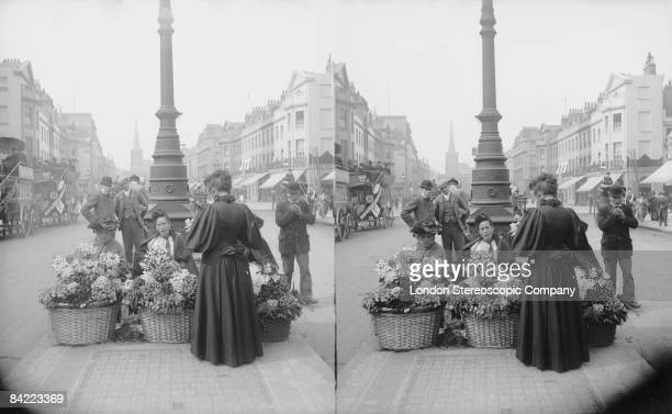 Flower sellers with their baskets of wares in London's Regent Street circa 1900