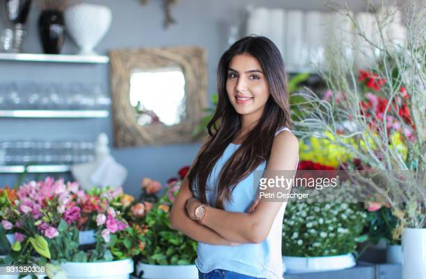 flower shop girls - indian beautiful girls stock photos and pictures