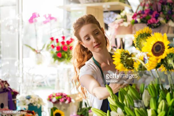 flower shop led by young woman - homegrown produce stock pictures, royalty-free photos & images