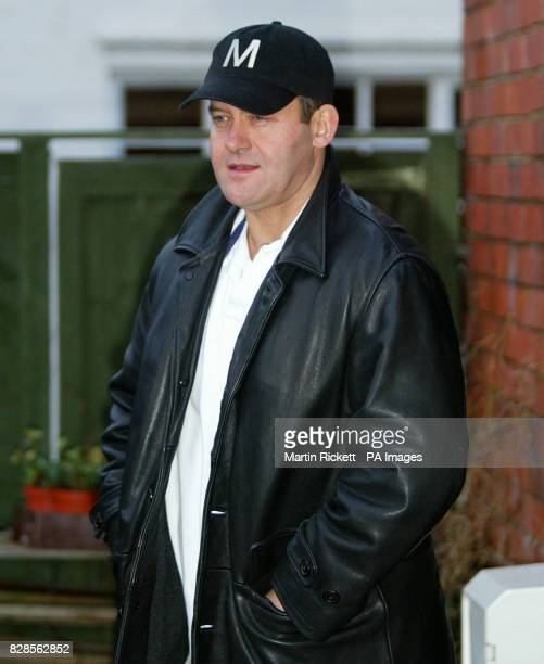 Flower shop owner and former royal butler Paul Burrell leaves his shop in Holt, Wrexham, following a suspected arson attack. * Mr Burrell was today...