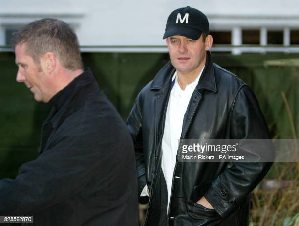 Flower shop owner and former royal butler Paul Burrell leaves his shop in Holt, Wrexham, with his body guard, following a suspected arson attack. *Mr...