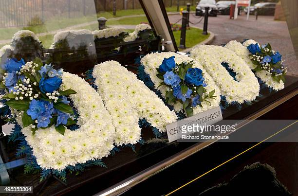 A flower tribute which spells the word 'Daddy' is displayed inside the hearse at the funeral of PC David Phillips at Liverpool Anglican Cathedral on...