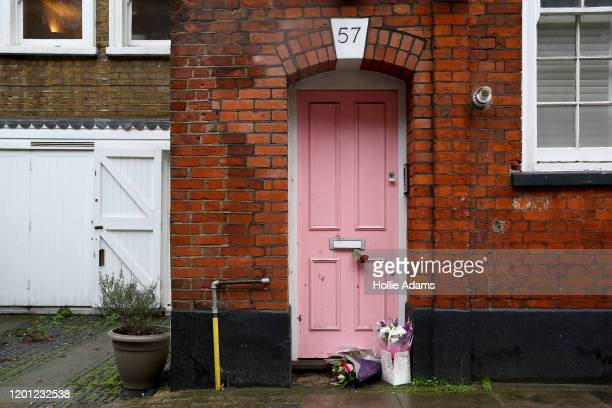 Flower tributes laid outside the home of former Love Island host Caroline Flack on February 16 2020 in London England The TV presenter was was found...