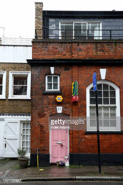 Flower tributes laid outside the home of former Love Island host Caroline Flack on February 16 2020 in London England The TV presenter was found dead...