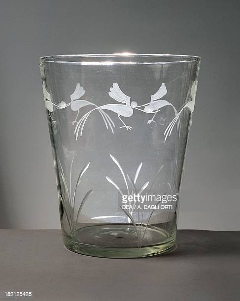 Flower vase in white glass with engravings around the rim depicting marsh grasses and wading birds in flight 19301939 engravings attributed to...