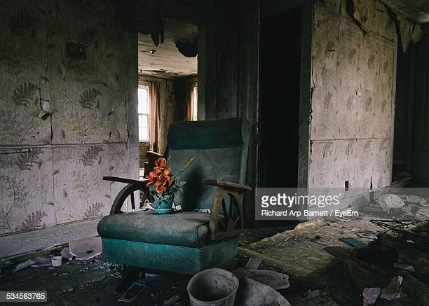 Flower Vase On Chair In Abandoned House