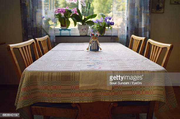 flower vase on dining table at home - dinner table stock photos and pictures