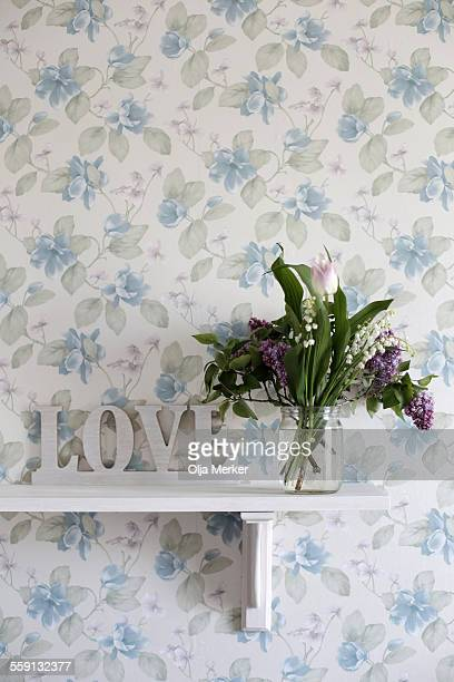 Flower vase on shelf at home