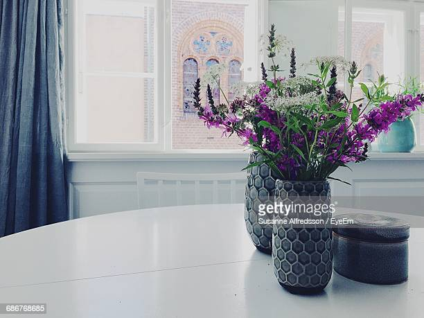 Flower Vases On Dining Table At Home