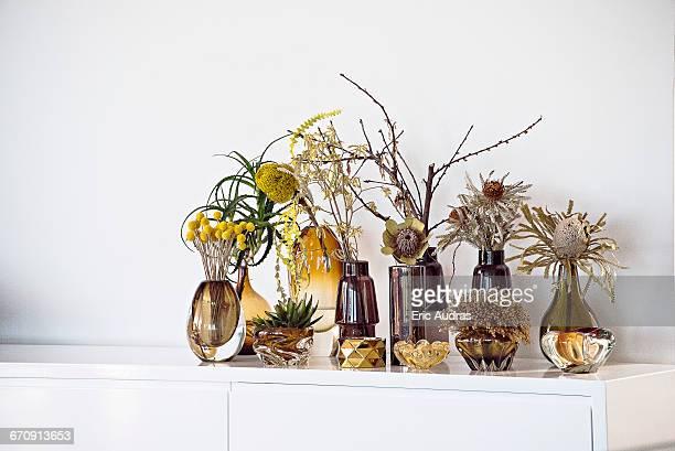 Flower vases on sideboard at modern home
