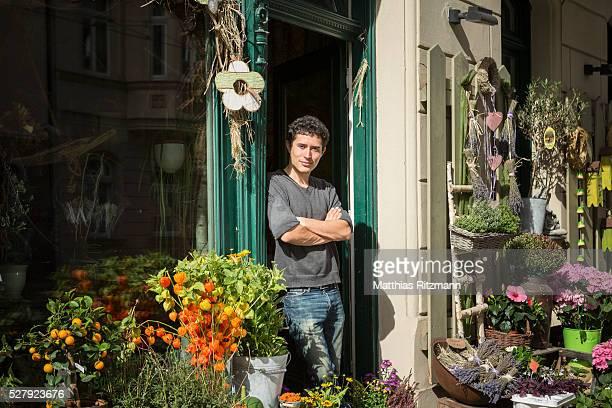 Flower vendor in doorway of shop