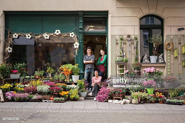 Flower vendors in doorway of shop