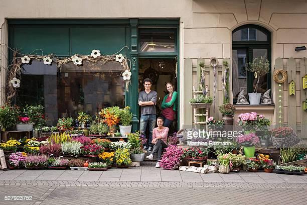 Flower vendors in doorway of shop