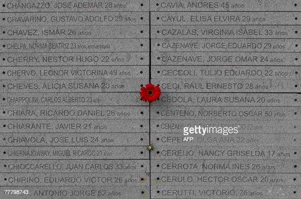 A flower was got caught betwen engraved names during the inauguration of the Monument to the Victims of State Terrorism at Parque Memoria on the...