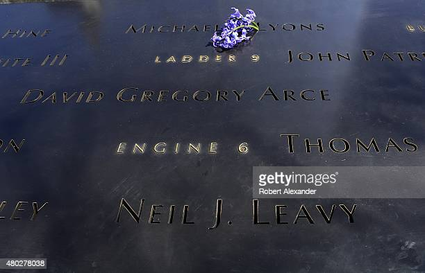A flower was placed by a visitor at the '9/11 Memorial' in Lower Manhattan in New York NY into a name of one of the victims of the 2001 World Trade...