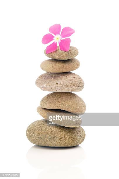 Flower With Stack Of Pebbles