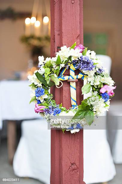 Flower wreath on wooden post