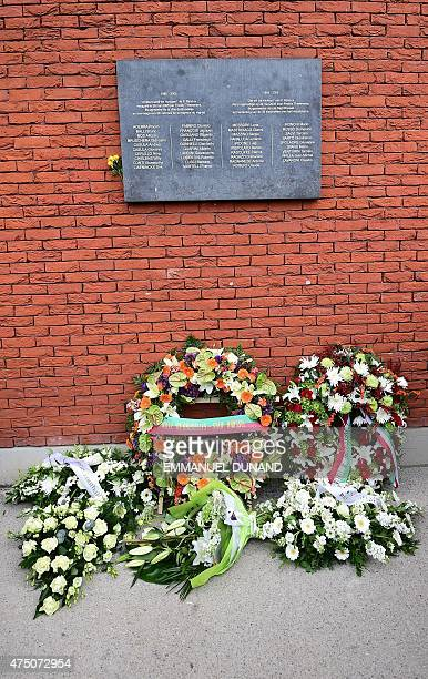 Flower wreaths are seen under a plaque bearing the names of the victims of the Heysel Stadium tragedy during a ceremony marking the 30th anniversary...