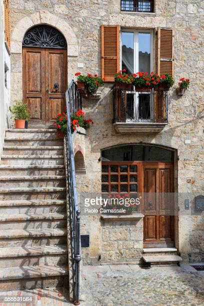 Flowering plants in a courtyard of Civitella del Tronto, Italy