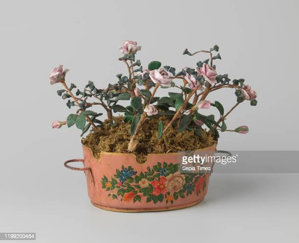 Flowerpot flower box by metal Peint with roses and forgetmenots The oval bowl with scalloped edge displays a tuft of flowers in blue white red and...