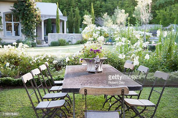 Flowerpot on table in garden
