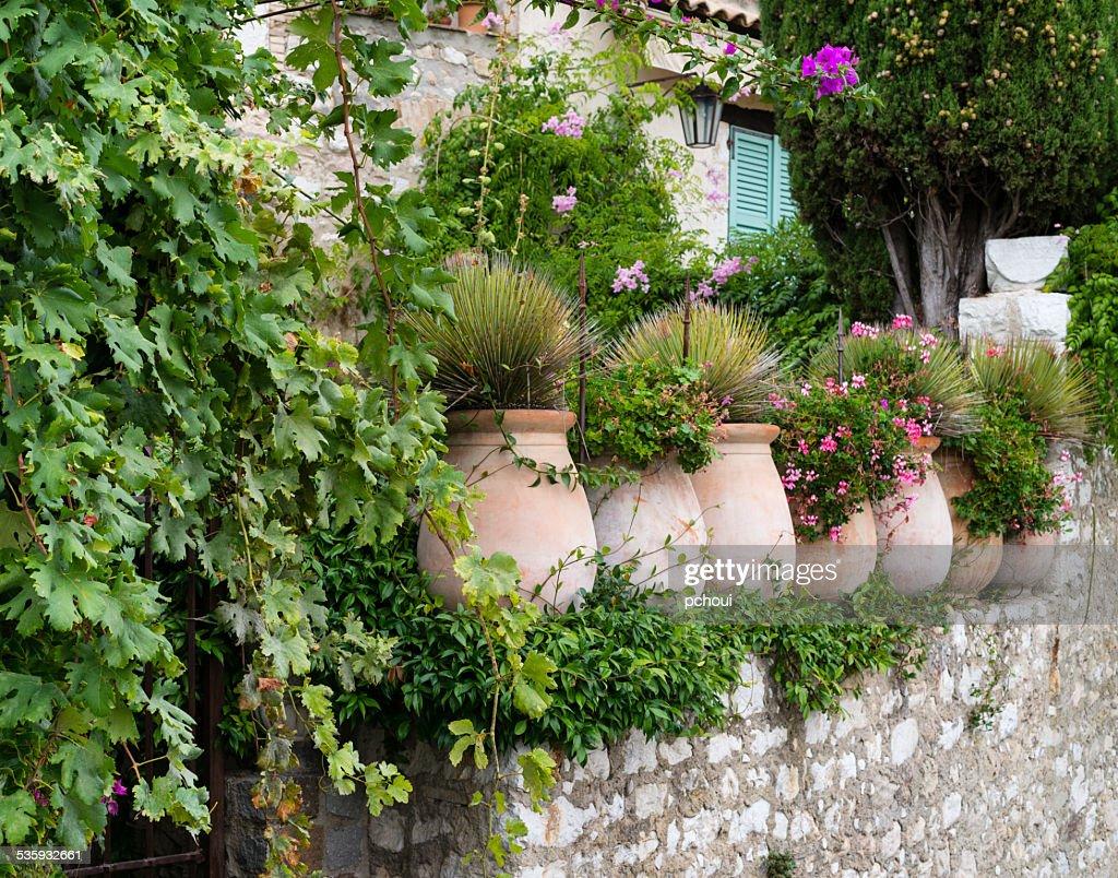 Flowerpots in medieval village, France : Stock Photo