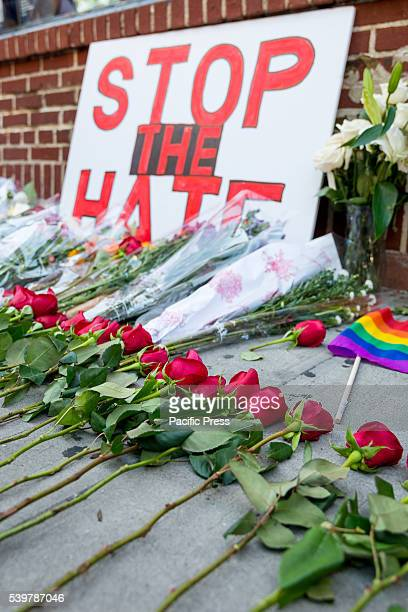 Flowers adorn a shrine to the fallen along the facade of The Stonewall Inn In tribute to the memory of the 50 dead and dozens wounded in the mass...