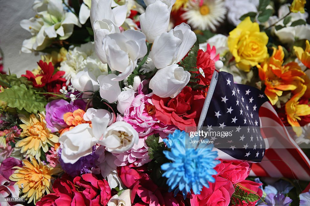 Flowers adorn front of the Emanuel AME Church on the one-month anniversary of the mass shooting on July 17, 2015 in Charleston, South Carolina. Visitors from around the nation continue to pay their respects at a makeshift shrine at the church, in a show of faith and solidarity with 'Mother Emanuel', as the church is known in Charleston. Nine people were allegedly murdered on June 17 by 21-year-old white supremacist Dylann Roof, who was captured by police in North Carolina the following day. He is scheduled to go to trial July 11, 2016.