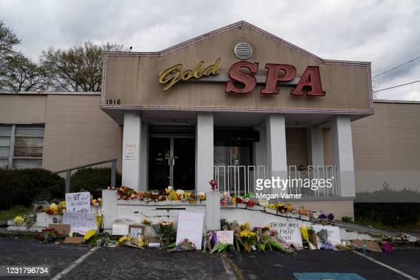 Flowers adorn Gold Spa during a demonstration against violence against women and Asians following Tuesday night's shooting where three women were...
