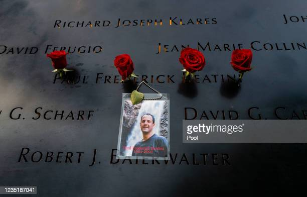 Flowers adorn the name of Paul Frederick Beatini during a ceremony at the 9/11 Memorial and Museum on September 11, 2021 in New York City. The nation...