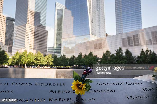 Flowers adorn the names of the fallen victims of the September 11 2001 terrorist attacks During the formal ceremony at Ground Zero to commemorate the...