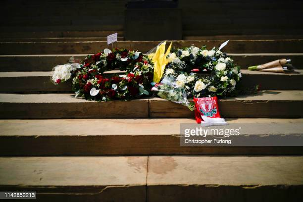 Flowers adorn the steps outside Liverpool's Saint George's Hall as people pay their respects on the 30th anniversary of the Hillsborough tragedy on...