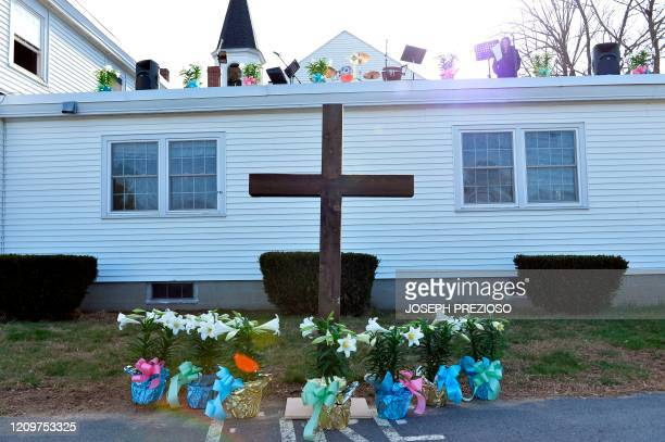 Flowers and a cross decorate the church at an Easter Service at the First Baptist Church in Plaistow New Hampshire on April 12 2020 Since the Covid19...