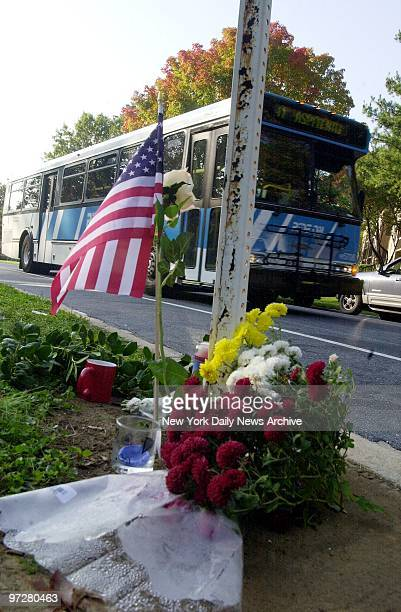 Flowers and a flag adorn a makeshift memorial on Grand Pre Road in Aspen Hills Md where a bus driver was fatally wounded yesterday The police...