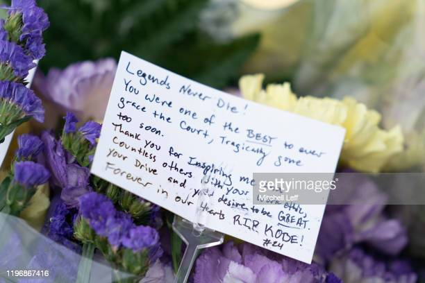 Flowers and a message are left at a memorial for former Los Angeles Laker Kobe Bryant after he was killed in a helicopter crash at Lower Merion High...