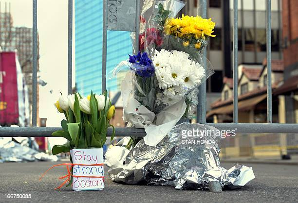 Flowers and a message are left on Newbury Street April 16 2013 in Boston Massachusetts a few blocks from where two explosions struck near the finish...