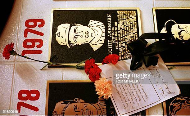 Flowers and a message are placed next to the plaque for Richie Ashburn on the Philadelphia Phillies Wall of Fame in Veterans Stadium in Philadelphia...