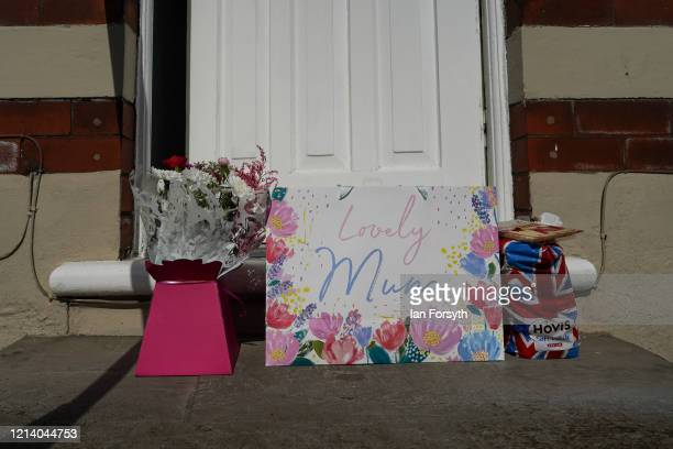 Flowers and a Mother's Day gift, a loaf of bread and some cheese are left on the doorstep of a house in Saltburn By The Sea as the UK adjusts to life...