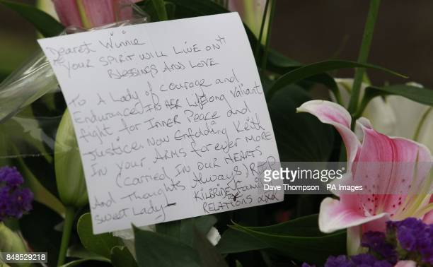 Flowers and a note from the family of John Kilbride who was killed by Ian Brady and Myra Hindley at the funeral service of Winnie Johnson mother of...