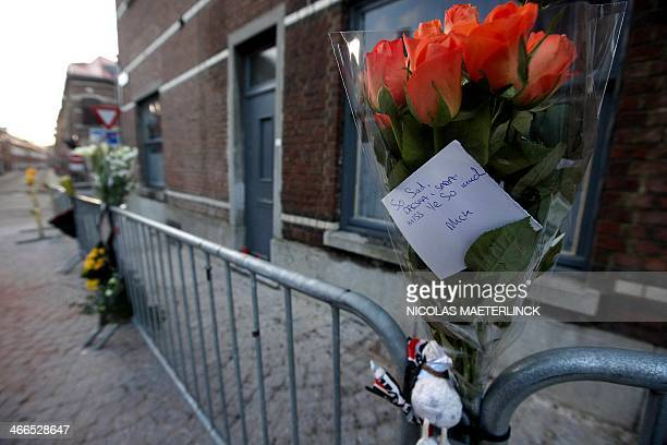 Flowers and a note hooked to a safety barrier in front of a destroyed university residence commemorates the death of two Irish exchange students who...