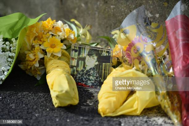 Flowers and a photo are left in tribute to journalist Lyra McKee near the scene of her shooting on April 19 2019 in Londonderry Northern Ireland...